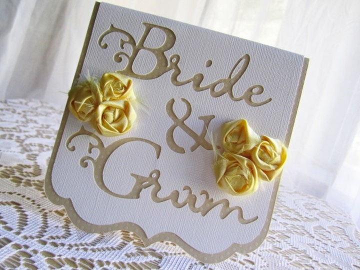 Beige-yellow-wedding-reception-table-cards.full