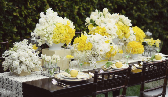 yellow ivory wedding flowers rananculus reception tablescape