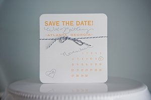 photo of elegant letterpress wedding save the date calendar design marigold navy