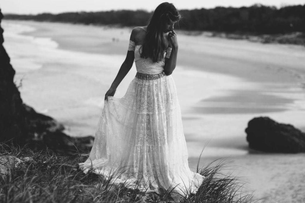 Bohemian bride at a beach wedding bridal gown beauty inspiration.