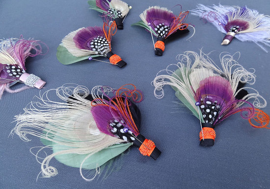 unique boutonnieres for grooms handmade weddings by Etsy orange purple sage feathers