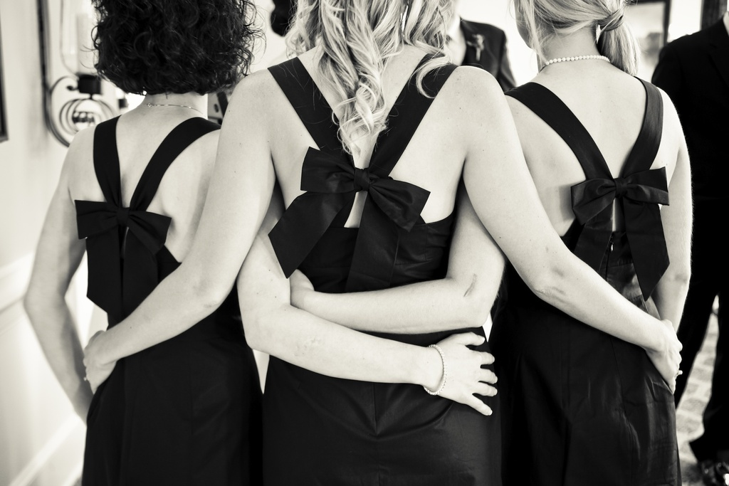Charming-country-club-wedding-bridesmaids-embrace.full