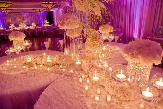 ivory wedding flowers purple lighting
