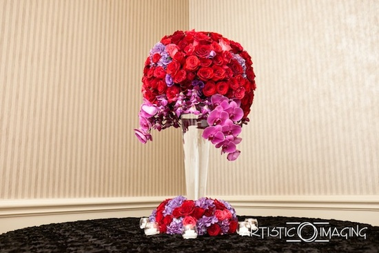 photo of wedding details reception decor inspiration by Jerri Woolworth red pink roses orchids topiary