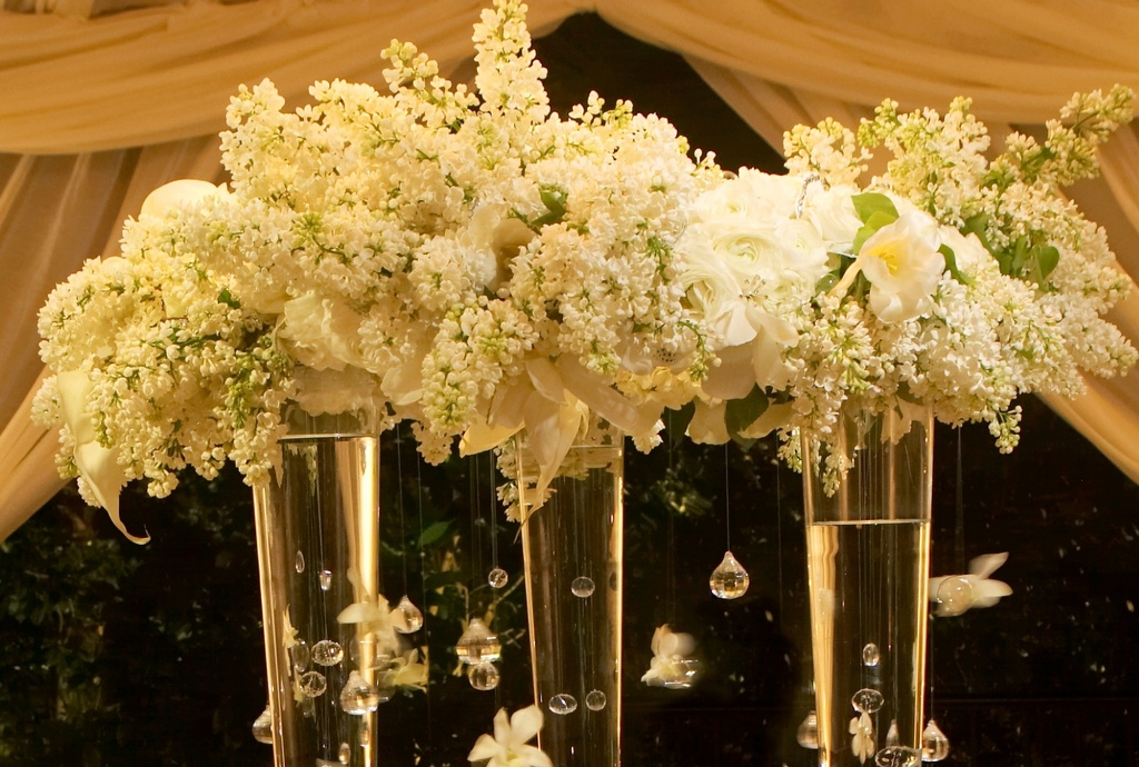 wedding details reception decor inspiration by Jerri Woolworth high topiaries ivory