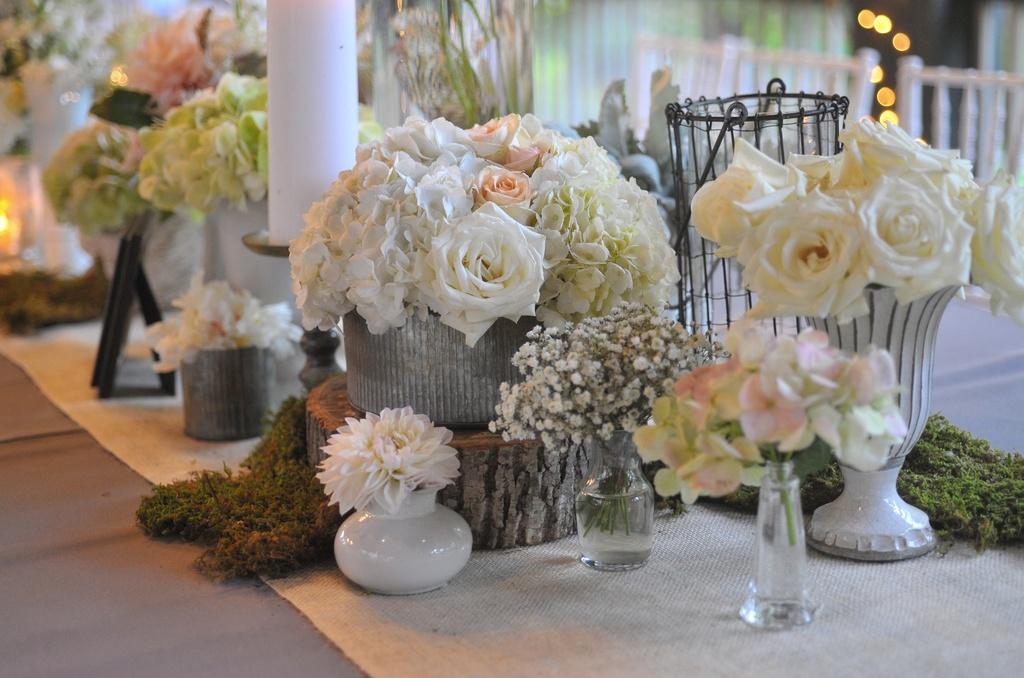 Elegant-real-wedding-north-carolina-wedding-photographers-romantic-centerpieces-roses-babys-breath.full