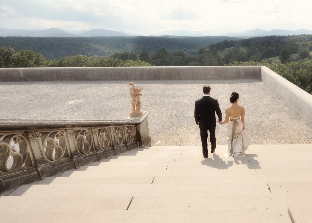 Elegant-real-wedding-north-carolina-wedding-photographers-bride-groom-hold-hands.full