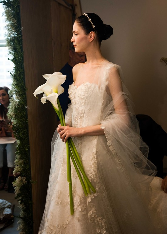 elegant wedding flowers oscar de la renta bridal gown