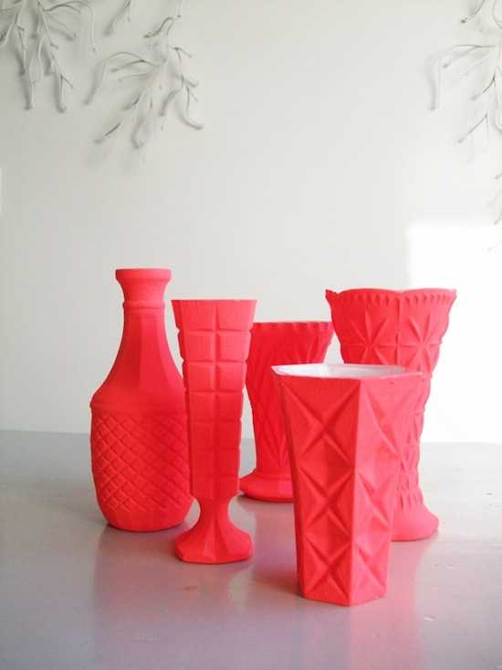 photo of bright coral vases for wedding reception