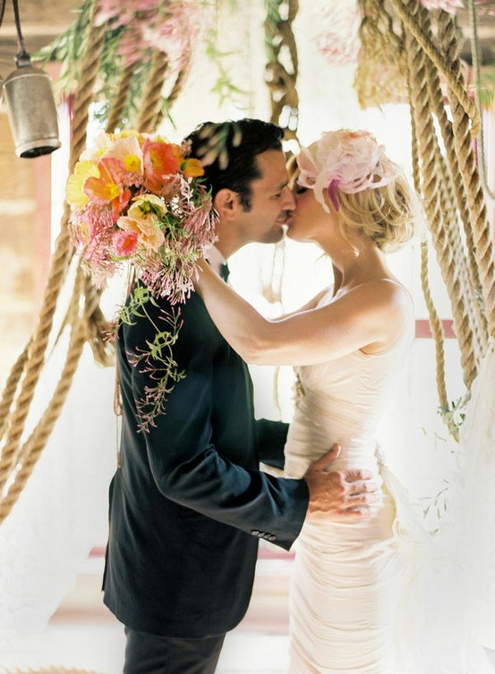 Bride And Groom Tying The Knot Kiss At Wedding Ceremony