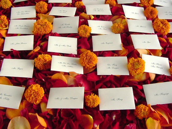 marigold wedding inspiration escort cards with rose petals