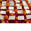 Marigold-wedding-inspiration-escort-cards-with-rose-petals.square