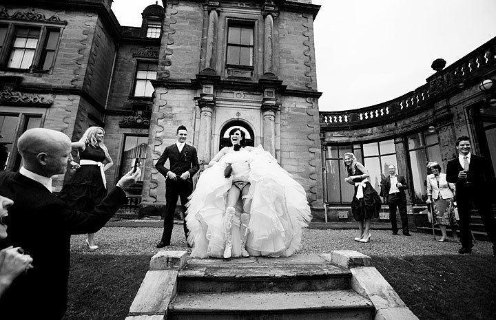 priceless wedding photos bride shows off whats beneath her dress