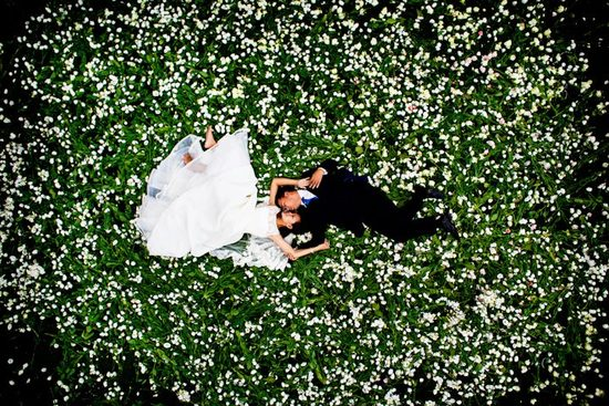 priceless wedding photos bride groom kiss in flowering field