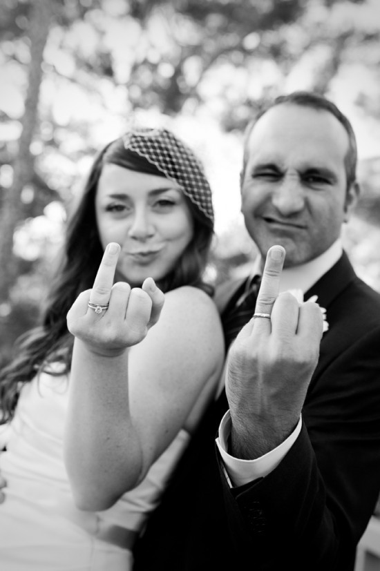 Priceless-wedding-photos-bride-groom-give-finger.full