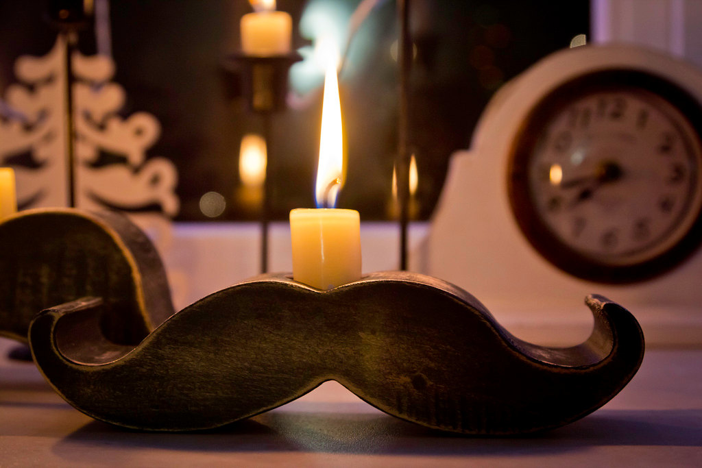 Fun-wedding-details-for-the-reception-mustache-theme-wedding-finds-reception-candle.original