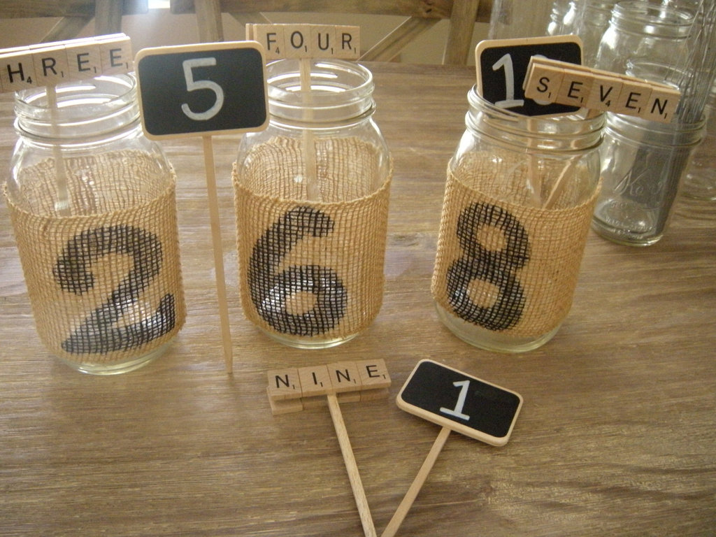 Wedding-theme-inspiration-scrabble-infused-weddings-mason-jar-centerpieces.full