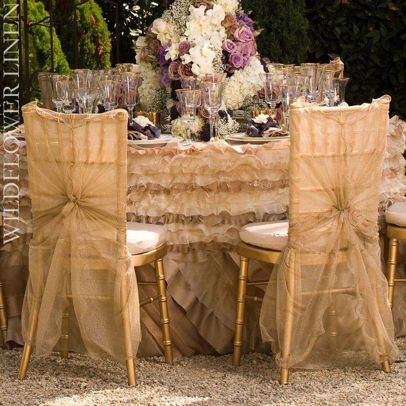 Wedding-reception-decor-inspiration-pretty-wedding-chairs-wildflower-linens-ivory-champagne.full