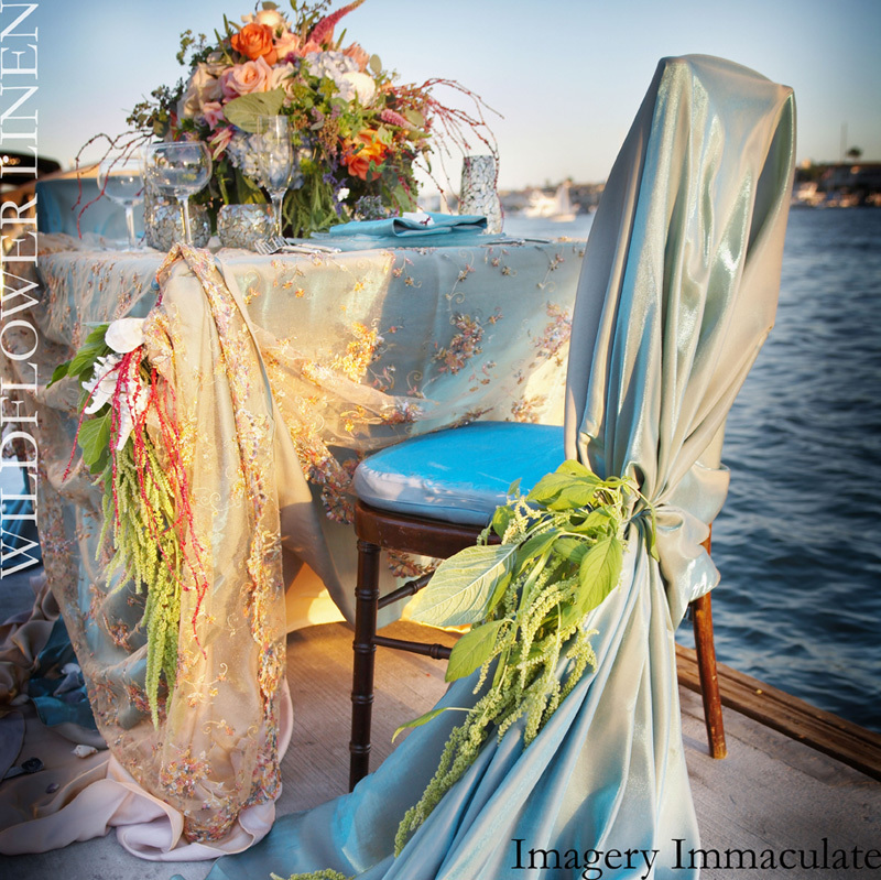 Ruffle-adorned-wedding-chairs-draped-chiavari-beach-wedding.full