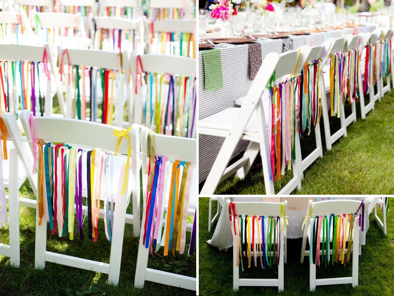 pretty wedding chairs colorful rainbow ribbons