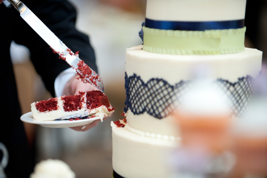 Real-wedding-with-a-unique-theme-bride-groom-at-reception-red-velvet-cake.full