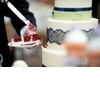 Real-wedding-with-a-unique-theme-bride-groom-at-reception-red-velvet-cake.square