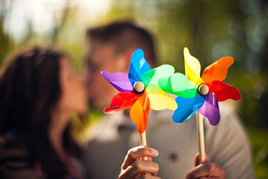 photo of wedding photography unique engagement session outdoors rustic romance colorful pinwheels