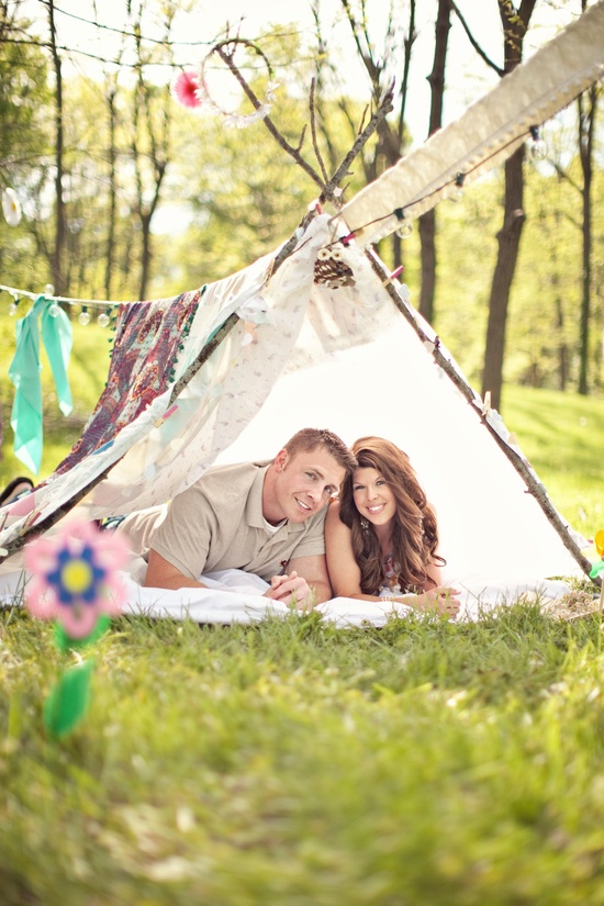 photo of wedding photography unique engagement session outdoors rustic romance bride groom in teepee