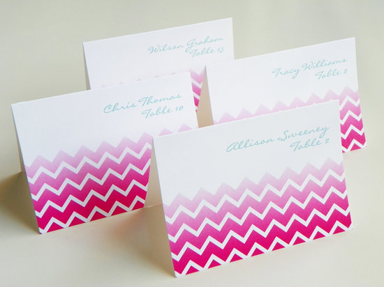 white pink aqua chevron wedding escort cards