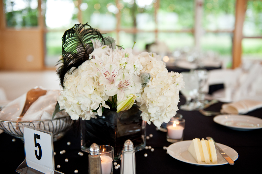 White-wedding-flowers-we-love-hydrangea-with-black-feathers.full