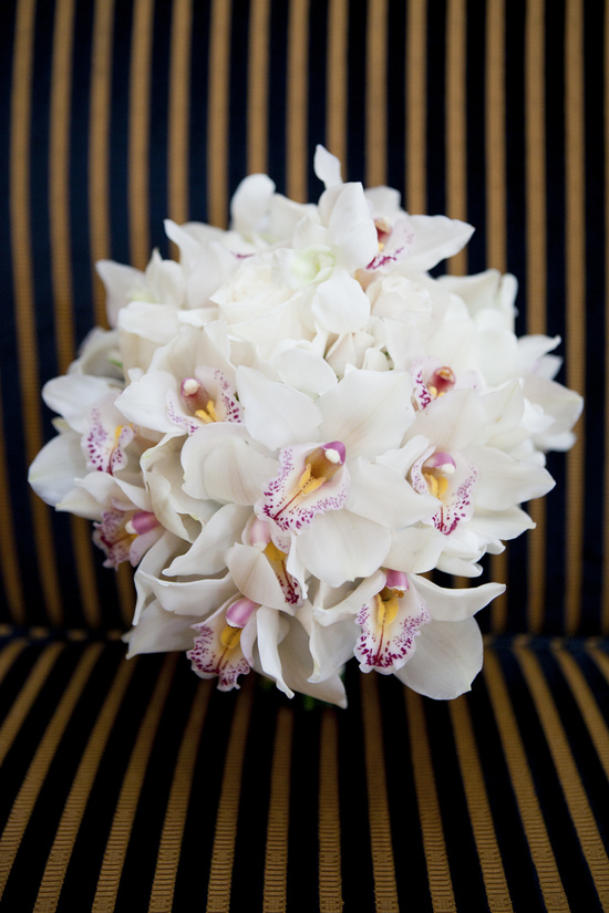 white orchid bridal bouquet with touches of pink
