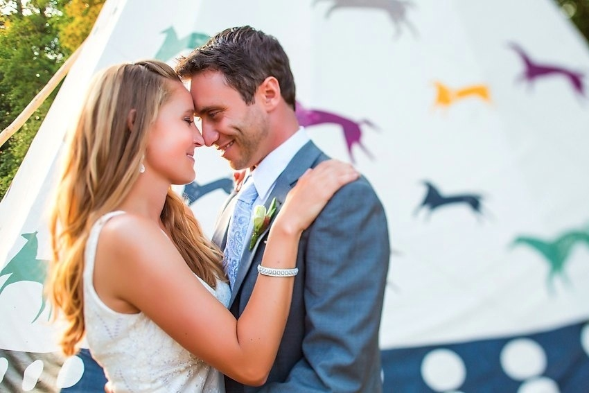 2012 wedding trends outdoor reception venues teepees not tents bride groom embrace