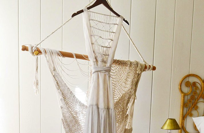 Celebrity-wedding-simple-bohemian-vibe-statement-back-wedding-dress-on-hanger.full