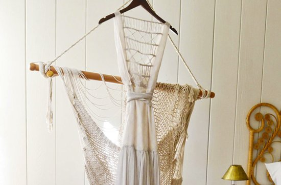 celebrity wedding simple bohemian vibe statement back wedding dress on hanger