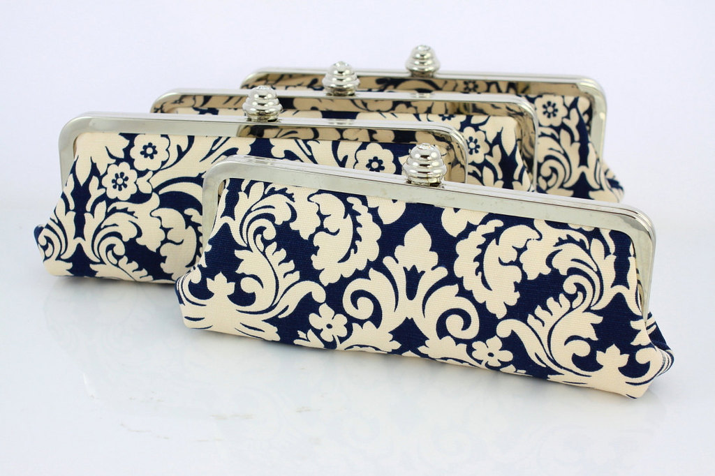 Wedding-color-inspiration-navy-blue-ceremony-reception-finds-bridesmaid-clutches.full