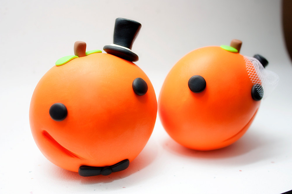 handmade wedding finds for Halloween themed I Dos adorable pumpkin cake topper