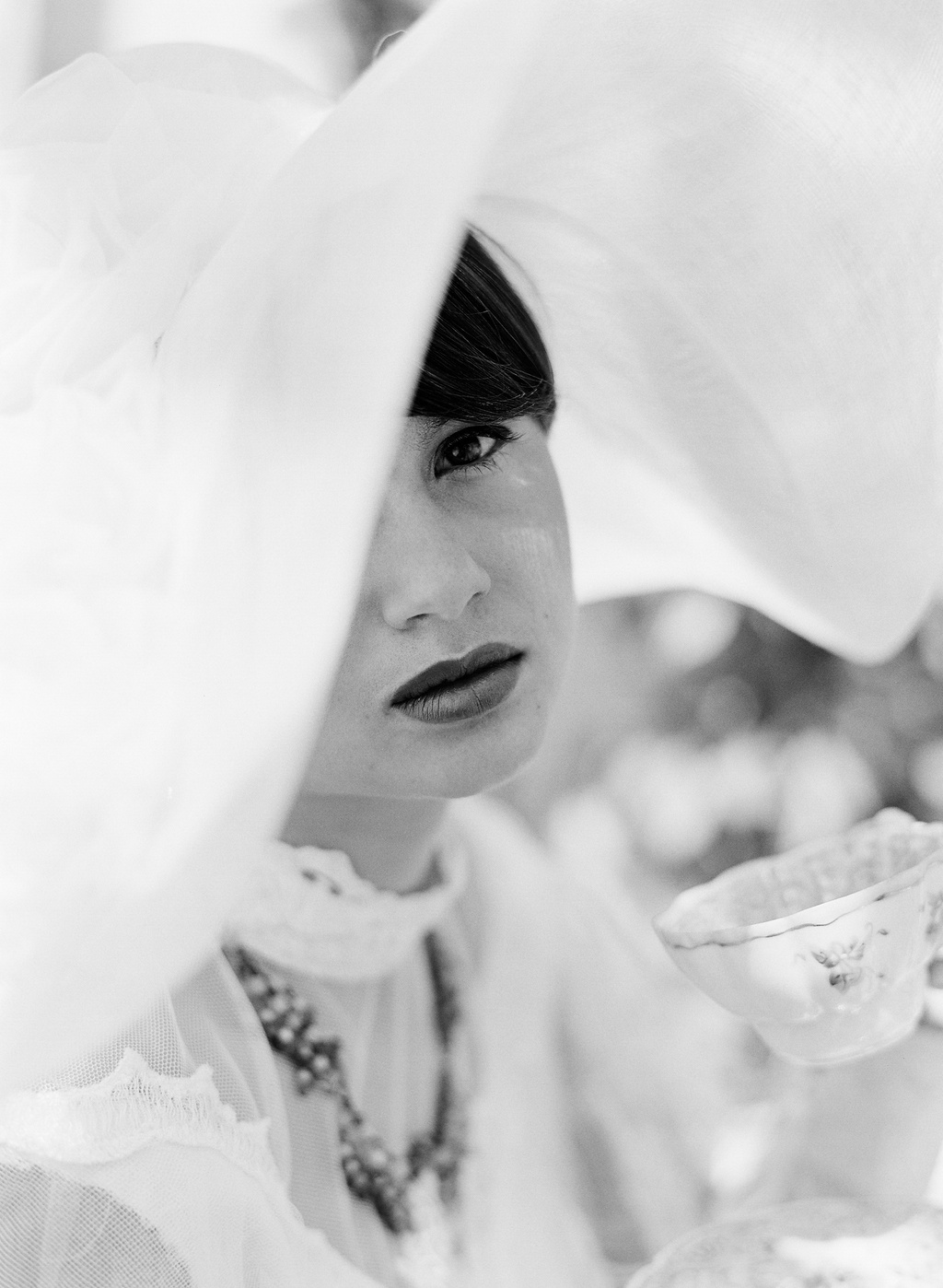 Styled-wedding-beaux-arts-tea-time-monique-lhuillier-santa-barbara-chic-bride-hat-black-and-white-95.full