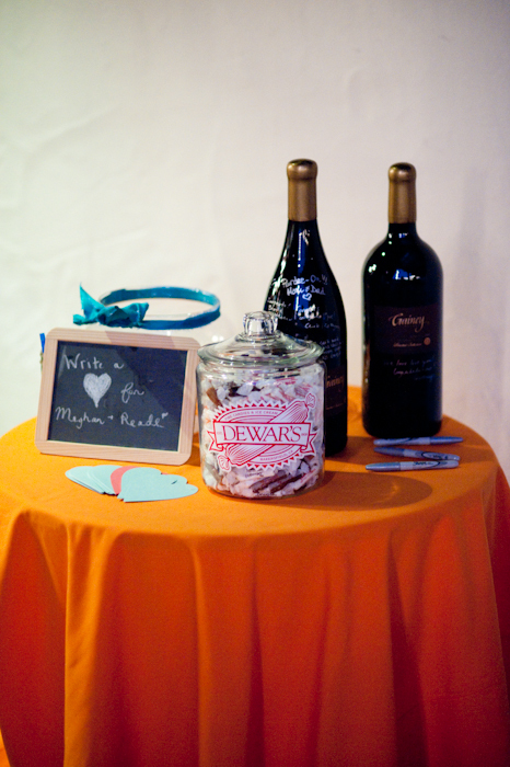 Real-wedding-santa-barbara-chic-michael-and-anne-costa-photography-outdoor-winery-vibrant-colors-guest-book-champagne-candy-jar-510.full