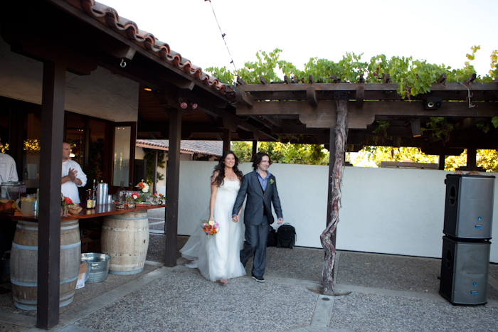 Real-wedding-santa-barbara-chic-michael-and-anne-costa-photography-outdoor-winery-vibrant-colors-bride-groom-entrance-405.full
