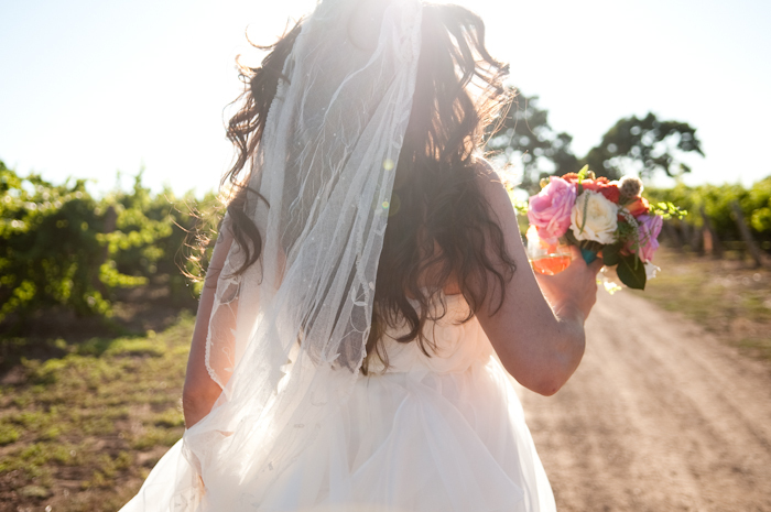 Real-wedding-santa-barbara-chic-michael-and-anne-costa-photography-outdoor-winery-vibrant-colors-bride-wedding-dress-veil-bouquet-259.full
