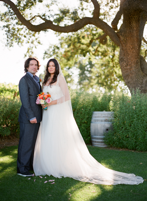 Real-wedding-santa-barbara-chic-michael-and-anne-costa-photography-outdoor-winery-vibrant-colors-bride-and-groom-wedding-dress-suit-veil-240.full