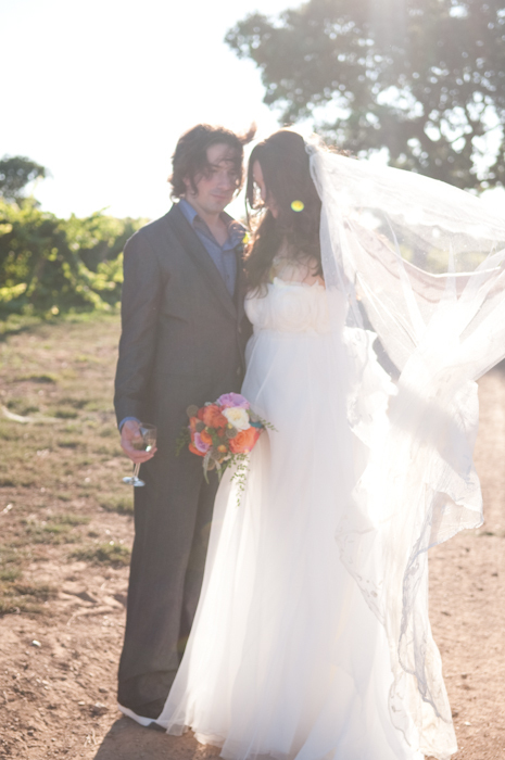 Real-wedding-santa-barbara-chic-michael-and-anne-costa-photography-outdoor-winery-vibrant-colors-bride-and-groom-wedding-dress-veil-bouquet-260.full