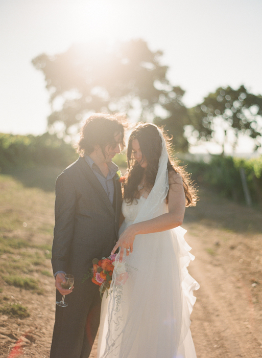 Real-wedding-santa-barbara-chic-michael-and-anne-costa-photography-outdoor-winery-vibrant-colors-bride-and-groom-wedding-dress-veil-bouquet-263.full