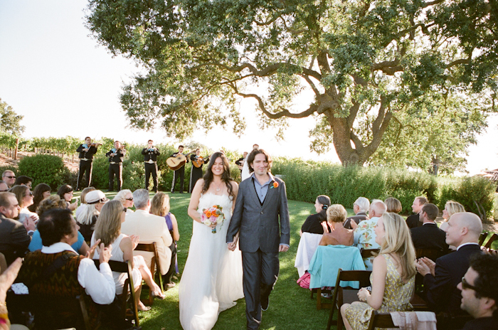 Real-wedding-santa-barbara-chic-michael-and-anne-costa-photography-outdoor-winery-vibrant-colors-bride-and-groom-wedding-dress-suit-veil-ceremony-venue-179.full