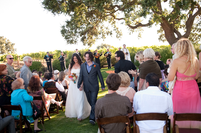 Real-wedding-santa-barbara-chic-michael-and-anne-costa-photography-outdoor-winery-vibrant-colors-bride-and-groom-wedding-dress-suit-veil-ceremony-venue-180.full