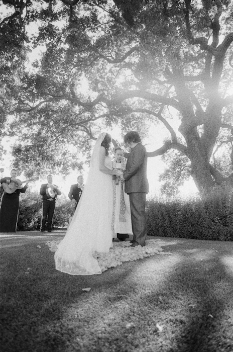 Real-wedding-santa-barbara-chic-michael-and-anne-costa-photography-outdoor-winery-vibrant-colors-bride-and-groom-wedding-dress-suit-veil-ceremony-venue-vows-black-and-white159.full