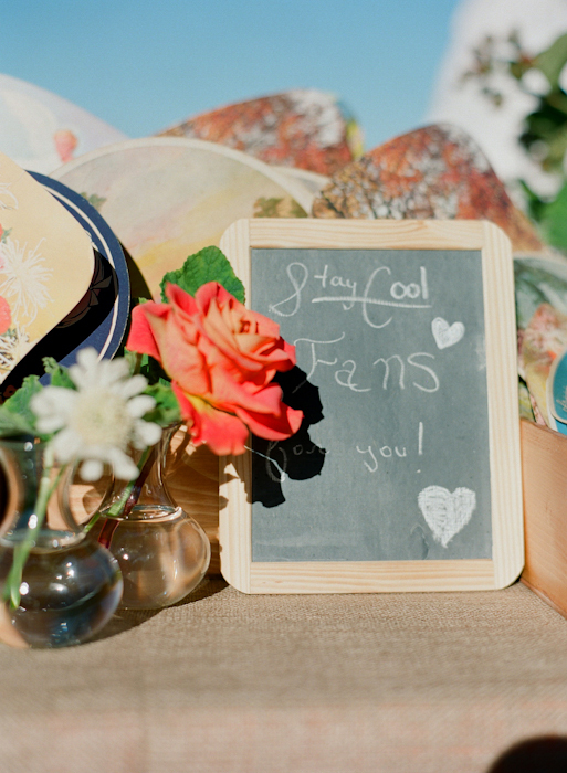Real-wedding-santa-barbara-chic-michael-and-anne-costa-photography-outdoor-winery-vibrant-colors-venue-decor-chalkboard-fans-vintage-080.full