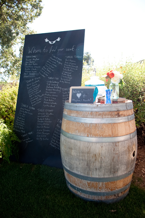 Real-wedding-santa-barbara-chic-michael-and-anne-costa-photography-outdoor-winery-vibrant-colors-venue-decor-chalkboard-seating-chart-wine-barrel-105.full