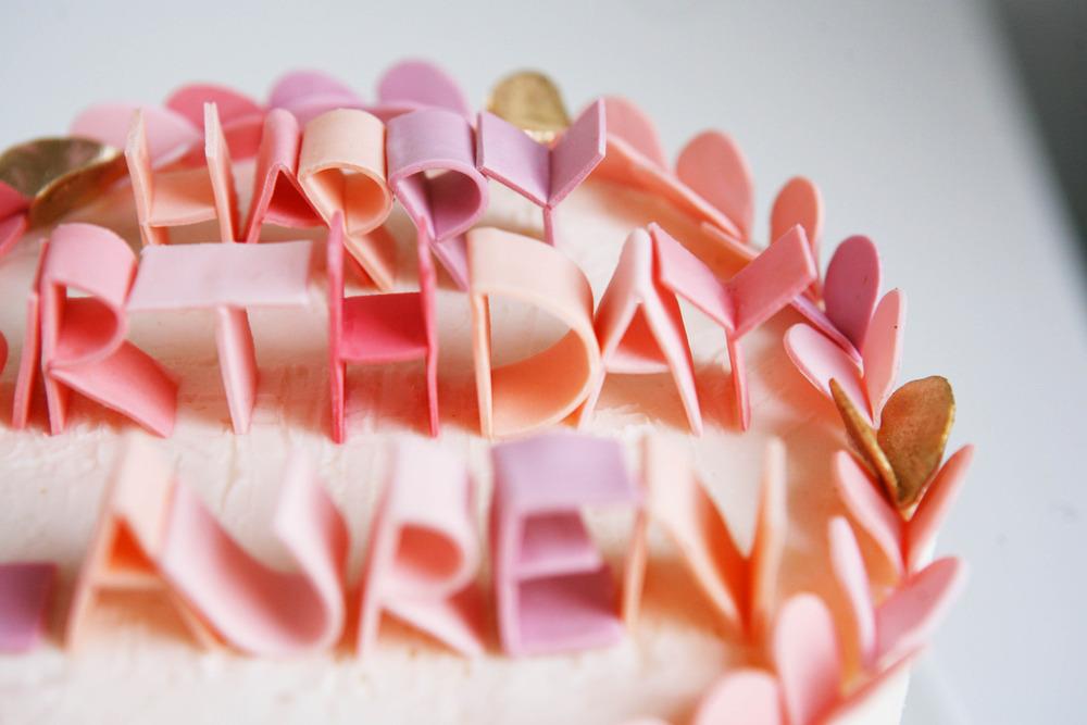 Custom-wedding-ideas-fondant-lettering-cake-topper-pastel-pink-peach.full