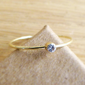 photo of 14k Solid Gold Diamond Engagement Ring by Etsy Seller Artemer, $152